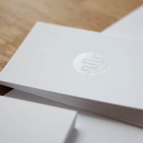Visitenkarten Folienpraegung transparent glänzend
